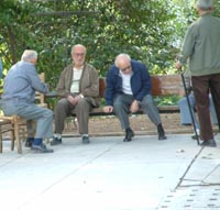 Gossiping in the sunshine.  Old men enjoying the fine weather of an Athens October